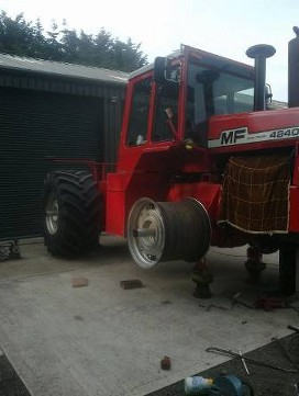 a tractor having it's wheels changed